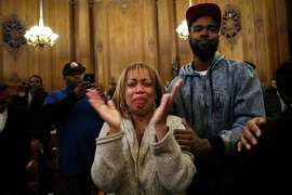 Gwen Woods, the mother of Mario Woods, who was fatally shot by S.F Police late last year, is overcome with emotion  after the Board of Supervisors unanimously approved a day of remembrance for Mario Woods, at City Hall, in San Francisco, California on Tuesday, January 26, 2016.