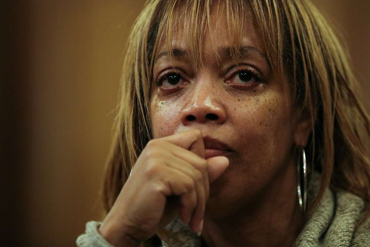 Gwendolyn Woods will get $400,000 in a settlement from the city over the 2015 police shooting of her son Mario.
