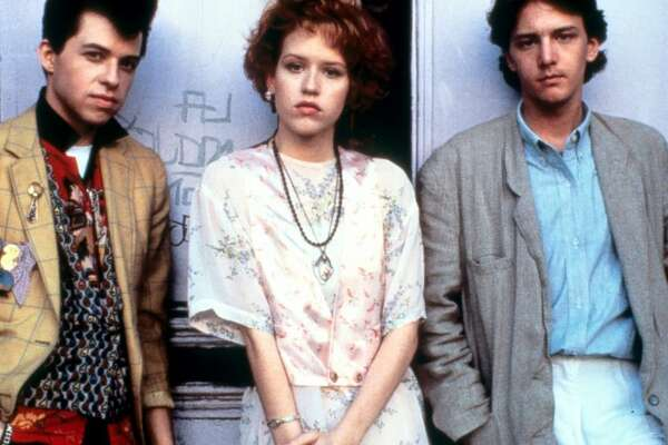 "Andie Walsh (Molly Ringwald) and Philip ""Duckie"" Dale (Jon Cryer), ""Pretty in Pink."" Although Andie ends up with rich boy Blane McDonough (Andrew McCarthy), she and her best friend Duckie looked so great together in their creative outfits. Their eclectic, mostly vintage ensembles were best described by Duckie himself as ""volcanic."""