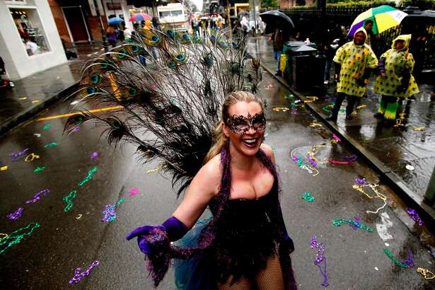 NEW ORLEANS, LA - MARCH 04:  Revelers party in the French Quarter despite the rain on Mardi Gras Day on March 4, 2014 in New Orleans, Louisiana. Fat Tuesday, or Mardi Gras in French, the traditional celebration on the day before Ash Wednesday and the begining of Lent, is marked in New Orleans with parades and marches through many neighborhoods in the city.  (Photo by Sean Gardner/Getty Images)