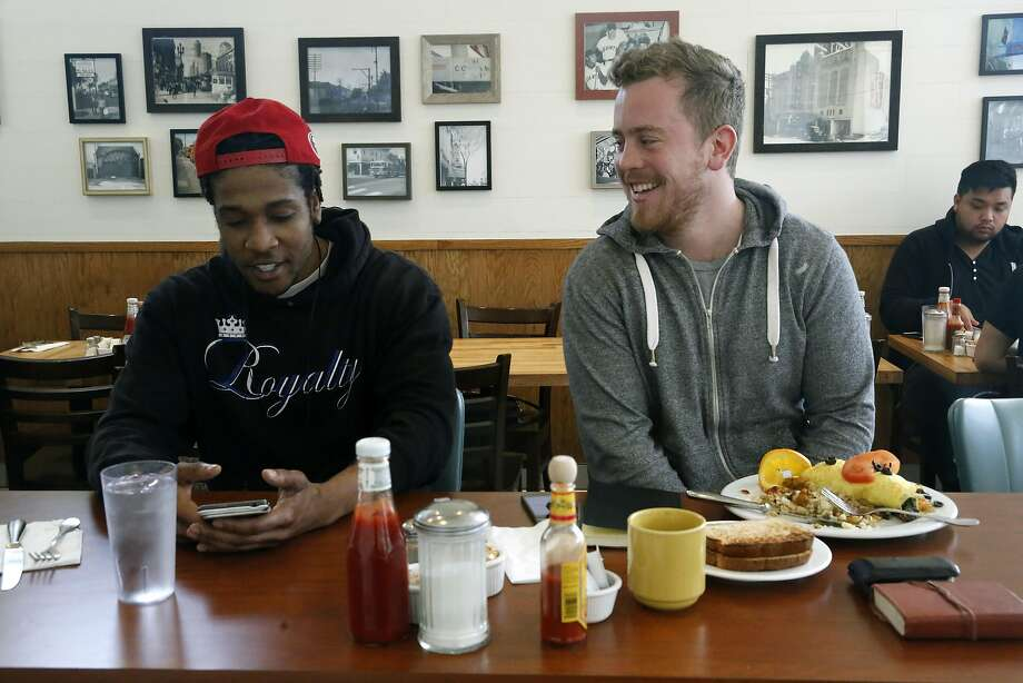 Bobby Morgan (left), who worked at the restaurant when he was 15, and Evan McSweeney at the counter at Breakfast at Tiffany's in S.F. Photo: Liz Hafalia, The Chronicle