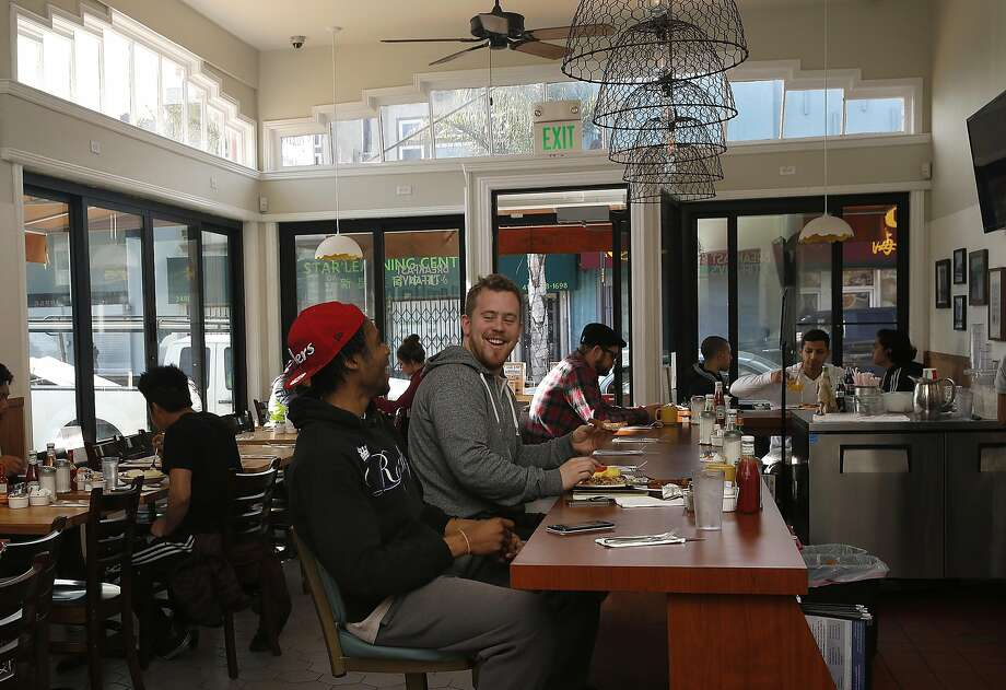 Bobby Morgan (left), who worked as a busboy at the restaurant when he was 15, and Evan McSweeney at the counter at Breakfast at Tiffany's in S.F. Photo: Liz Hafalia, The Chronicle