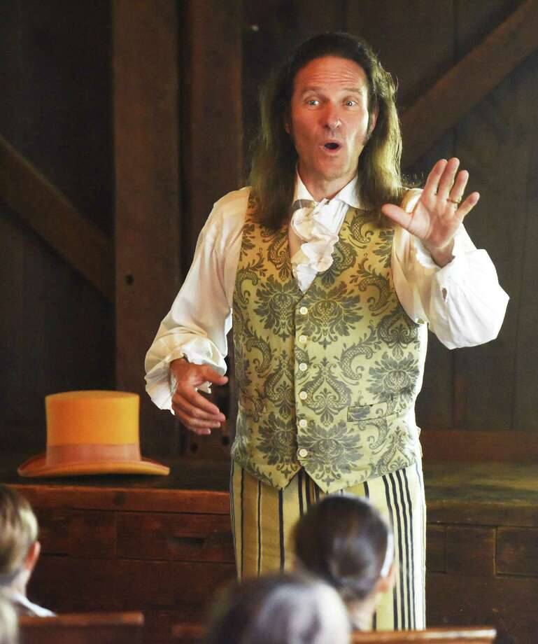 Historical storyteller Jonathan Kruk gives a performance during the Greenwich Historical Society History and Art Camp at the Bush-Holley House in Greenwich, Conn. Sunday, June 7, 2015. Photo: Tyler Sizemore / Hearst Connecticut Media / Greenwich Time