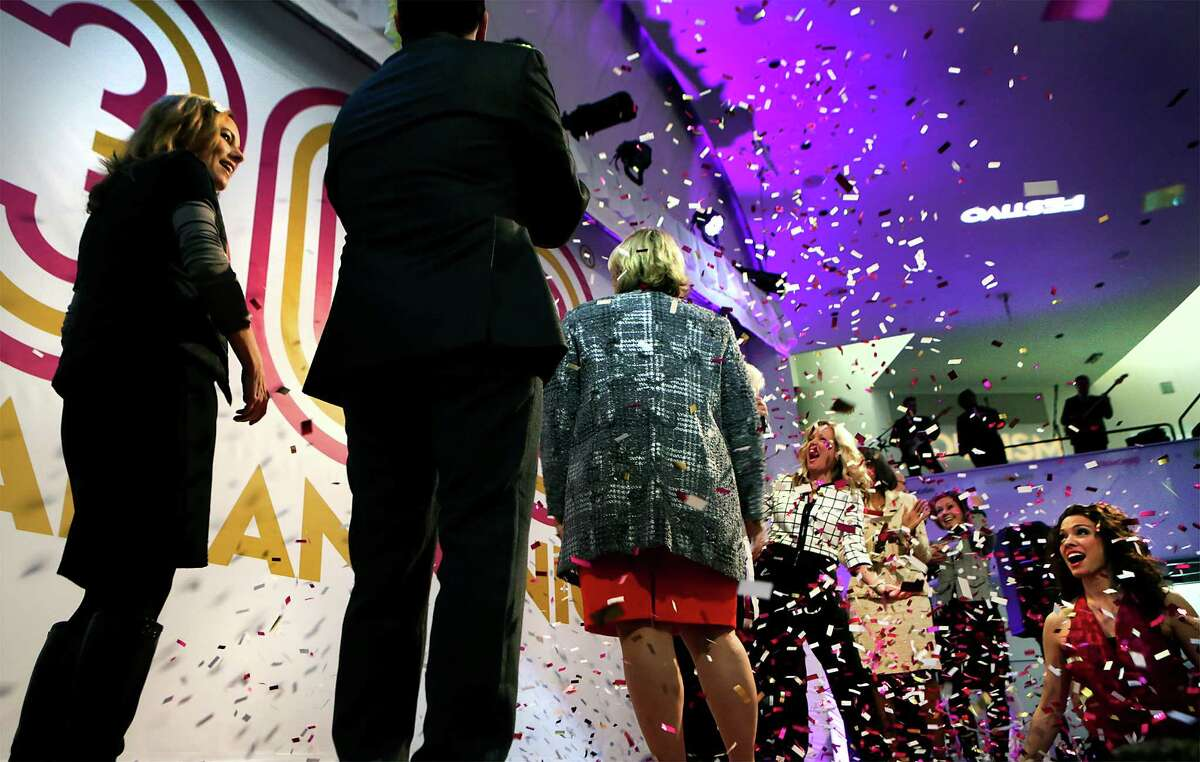 Confetti flys as city, county, and civic leaders gathered at the Tobin Center for the kick-off and unveiling of the official Tricentennial logo on Wednesday, Jan. 27, 2016.