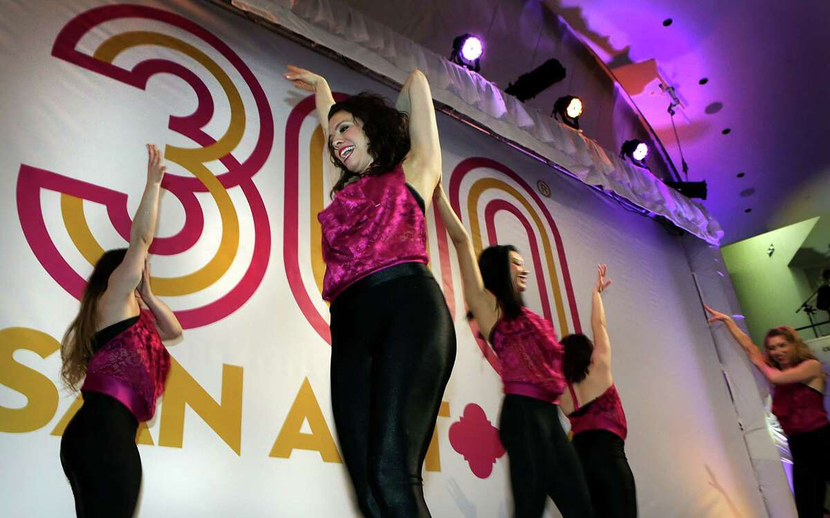 Members of the Trilogy Dancers perform as city, county, and civic leaders gather at the Tobin Center for the kick-off and unveiling of the official Tricentennial logo on Wednesday, Jan. 27, 2016.