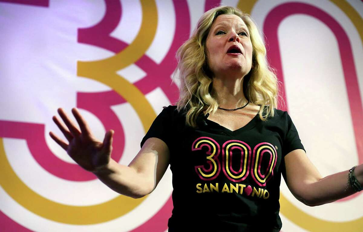 Asia Ciaravino, COO of the Tricentennial Commission makes an announcement as city, county, and civic leaders gather at the Tobin Center for the kick-off and unveiling of the official Tricentennial logo on Wednesday, Jan. 27, 2016.