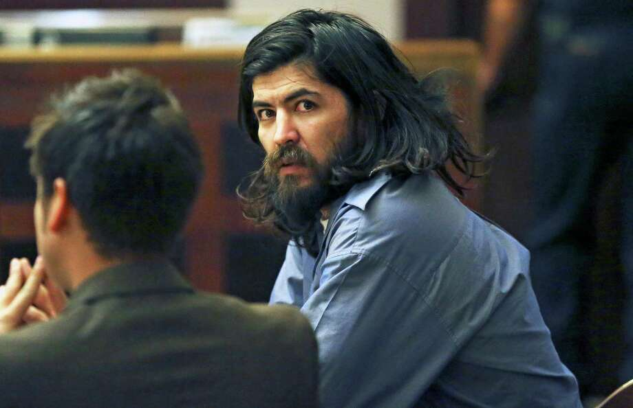 The defendant spends time staring around the courtroom at trial spectators during the murder trial of Christian Ivan Bautista in 186th State District Court of judge Jefferson Moore on January 27, 2016. Photo: TOM REEL, SAN ANTONIO EXPRESS-NEWS / 2016 SAN ANTONIO EXPRESS-NEWS