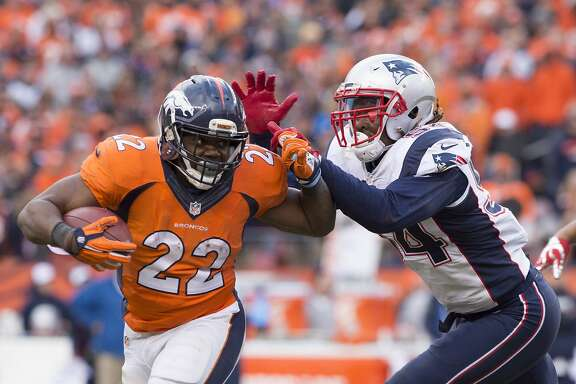 Broncos running back C.J. Anderson fights off Patriots defender Dont'a Hightower on a run during the fourth quarter of the AFC Championship game on Sunday, Jan. 24, 2016, at Sports Authority Field at Mile High in Denver. (Mark Reis/Colorado Springs Gazette/TNS)