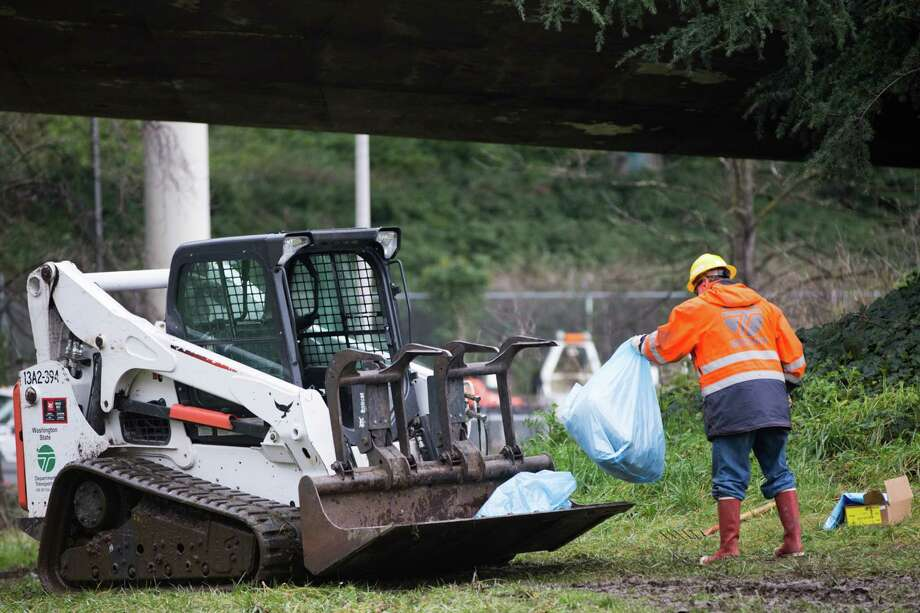 A federal lawsuit filed last week charges the city and the state have been violating the rights of people living outside by seizing and throwing away their personal property without a reasonable chance to move it or process to get it back.Pictured: A WSDOT worker loads the front of a skid steer during a clean up of an unsanctioned homeless camp near the Jungle in Sodo on Wednesday, Jan. 27, 2016. Photo: GRANT HINDSLEY, SEATTLEPI.COM / SEATTLEPI.COM