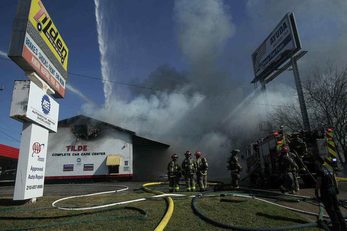 The Tilden Car Care Center at 9718 Perrin Beitel goes up in flames Wednesday January 27, 2016. Burning cars were visible from the front of the buliding. As of 2:15 p.m., San Antonio firefighters were still dousing the flames. The fire started at about 1:35 p.m..