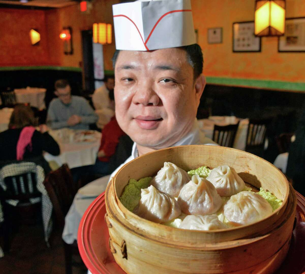Head chef Qing Sheng Zhou with steamed pork soup dumplings at A la Shanghai Thursday Jan. 21, 2016 in Colonie, NY. (John Carl D'Annibale / Times Union)