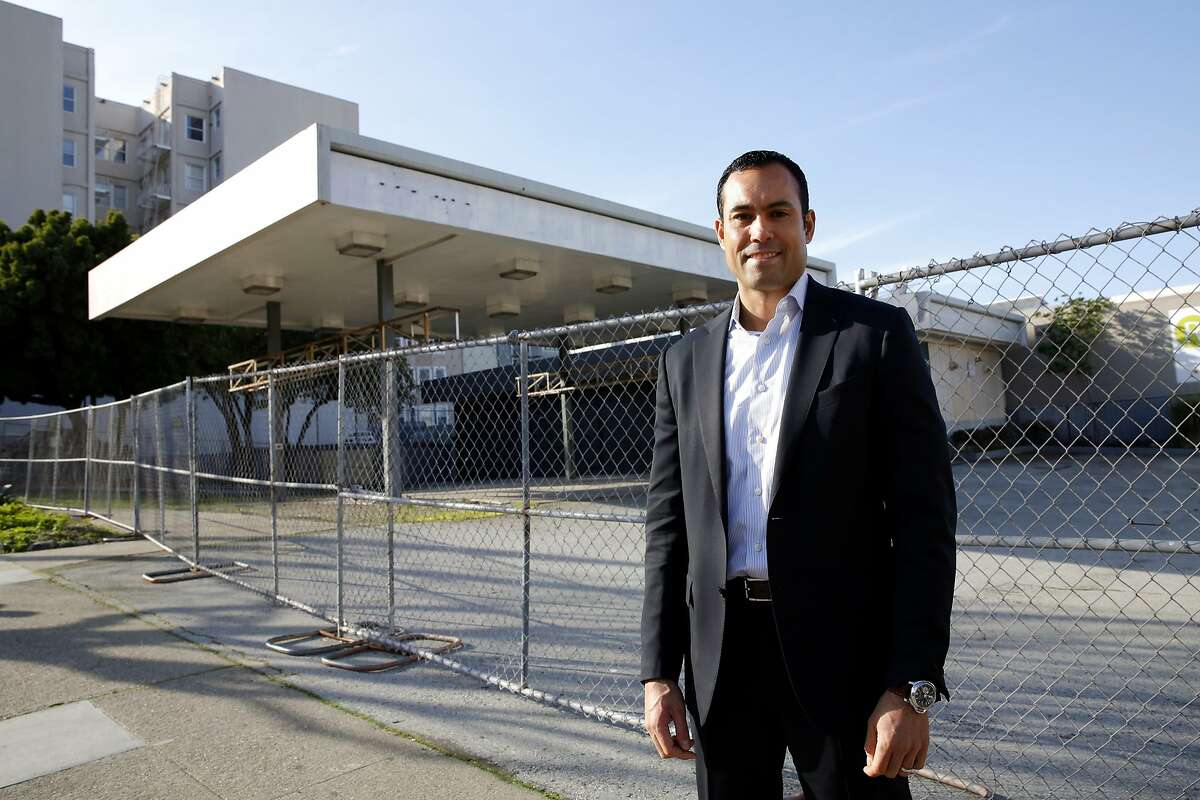 Mark MacDonald, principal at DM Development, stands beside a boarded-up gas station and lot he wants to develop in San Francisco, California, on Wednesday, Jan. 27, 2016.