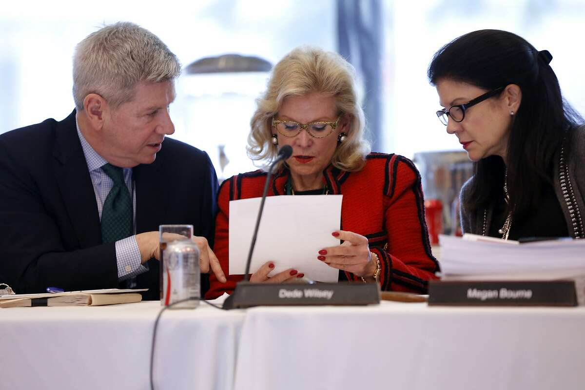 Richard Benefield (left), Dede Wilsey and Megan Bourne have a conversation before a Board of Trustees for the Fine Arts Museums of San Francisco meeting at the de Young Museum in San Francisco, California, on Tuesday, Jan. 26, 2016.