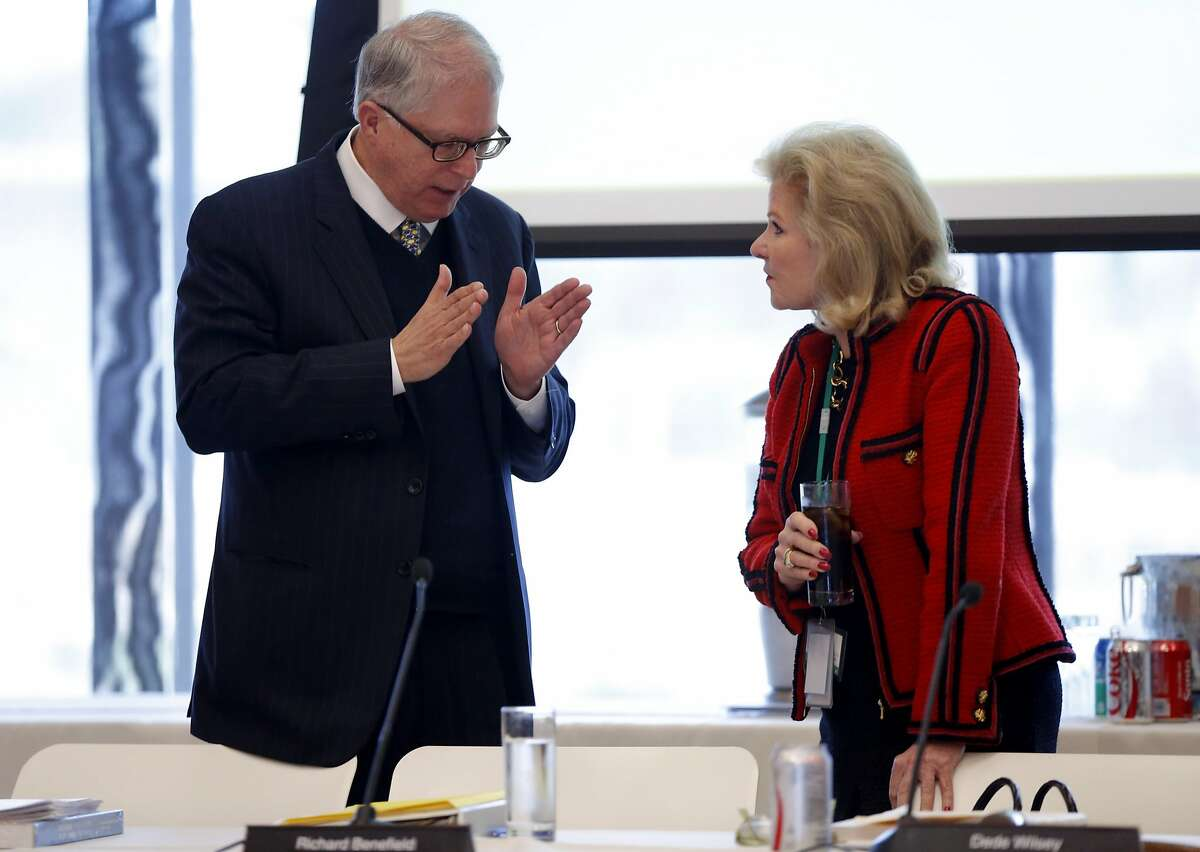 George Hecksher (left) and Dede Wilsey have a conversation before a Board of Trustees for the Fine Arts Museums of San Francisco meeting at the de Young Museum.