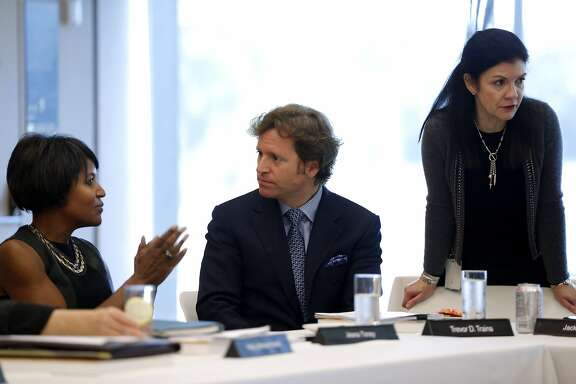 Trevor Traina (center) has a discussion before a Board of Trustees for the Fine Arts Museums of San Francisco meeting at the de Young Museum in San Francisco, California, on Tuesday, Jan. 26, 2016.