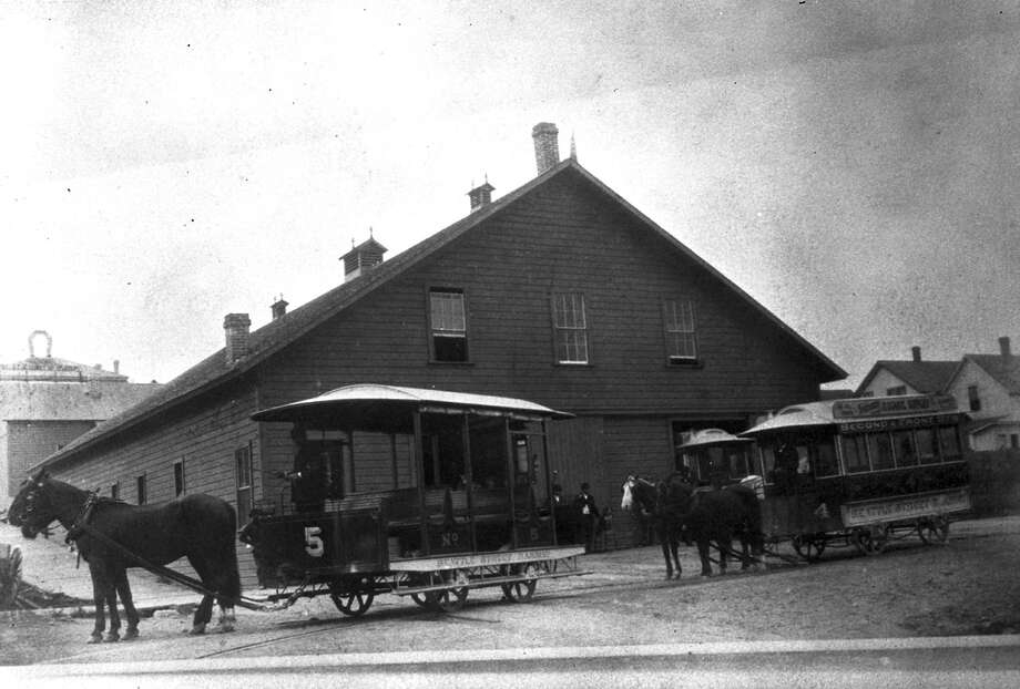 This archival photo shows a a Seattle Street Railway streecar barn at Second Avenue and Pike Street. Though the photo is dated 1880 in the archive, the city's first streetcar line -- drawn by horse -- did not begin service until Sept. 23, 1884. Streetcars converted to electric in 1889, so the photo would have been taken between those years. Photo courtesy Seattle Municipal Archives. Photo: Seattle Municipal Archives / 2016