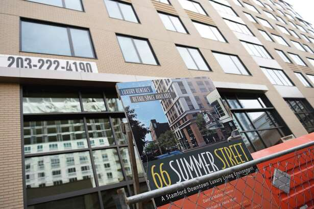 The 66 Summer Street luxury apartment site under construction in 2015 in Stamford, Conn. The city's swath of new housing erected downtown and in Harbor Point since the recession has successfully drawn residents who work in New York City.