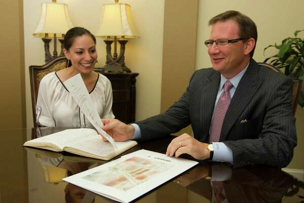 Stewart Information Services Corporation CEO Mathew Morris talks with Escrow Officer Claudia Huerta on Monday, June 3, 2013, in Houston. ( J. Patric Schneider / For the Chronicle )
