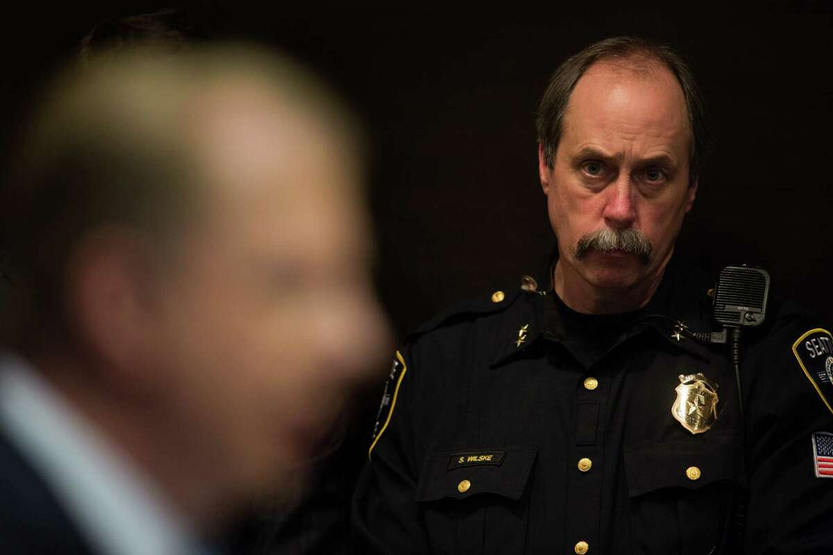 Assistant Chief Steve Wilske listens to Mayor Ed Murray speak at a press conference about last night's shooting at a homeless encampment and the ongoing homeless issue in Seattle, at Seattle City Hall on Wednesday, Jan. 27, 2016.