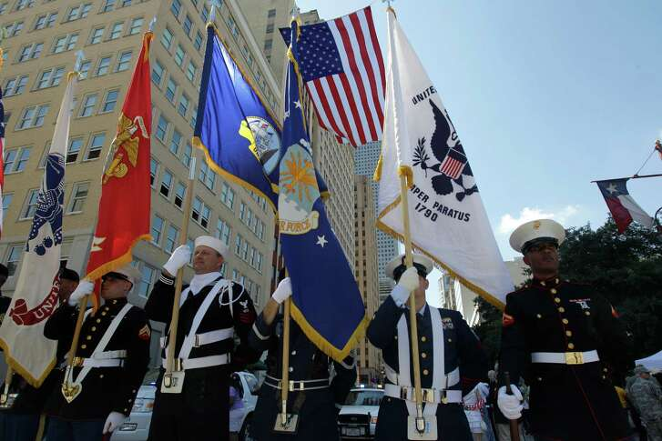 A joint military color guard readies to march along Texas Ave. during the Welcome Home Parade for Returning Iraq Veterans in downtown Saturday, April 7, 2012, in Houston. The event was sponsored by the City of Houston in partnership with the Astros 2012 opening weekend. ( Melissa Phillip / Houston Chronicle )
