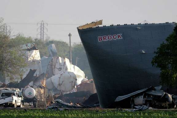The mangled remains of a fertilizer plant are shown the day after an explosion in West that killed 15.