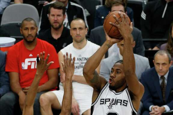 Spurs' Kawhi Leonard (02) shoots against Houston Rockets' Corey Brewer (33) at the AT&T Center on Wednesday, Jan. 27, 2016.