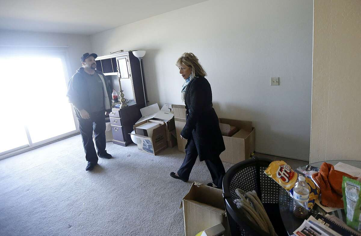 Rep. Jackie Speier, D-Calif., right, tours an apartment that resident Michael McHenry, left, evacuated in Pacifica, Calif., Wednesday, Jan. 27, 2016. El Nino storms delivering crashing waves and powerful rain storms have put homes perched atop coastal bluffs near San Francisco in danger, forcing residents of apartment complexes to leave. (AP Photo/Jeff Chiu)