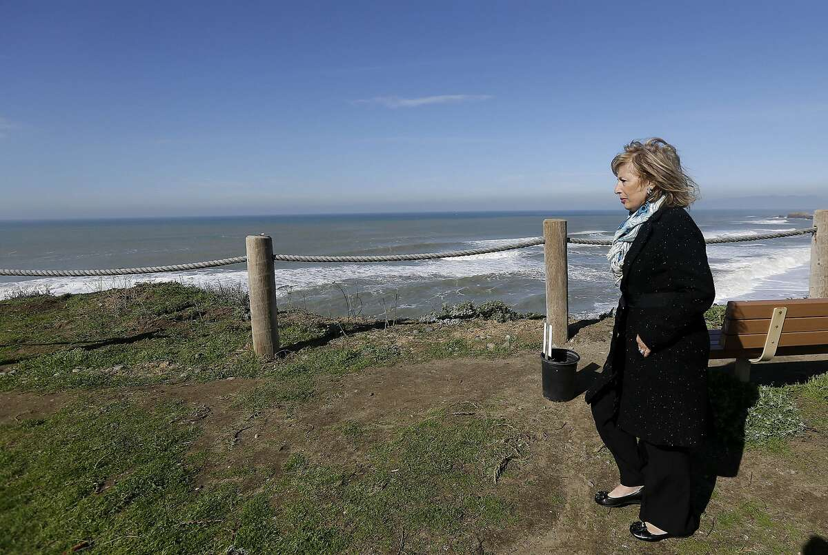 Rep. Jackie Speier, D-Calif., tours the shoreline next to evacuated apartment complexes in Pacifica, Calif., Wednesday, Jan. 27, 2016. El Nino storms delivering crashing waves and powerful rain storms have put homes perched atop coastal bluffs near San Francisco in danger, forcing residents of apartment complexes to leave. (AP Photo/Jeff Chiu)