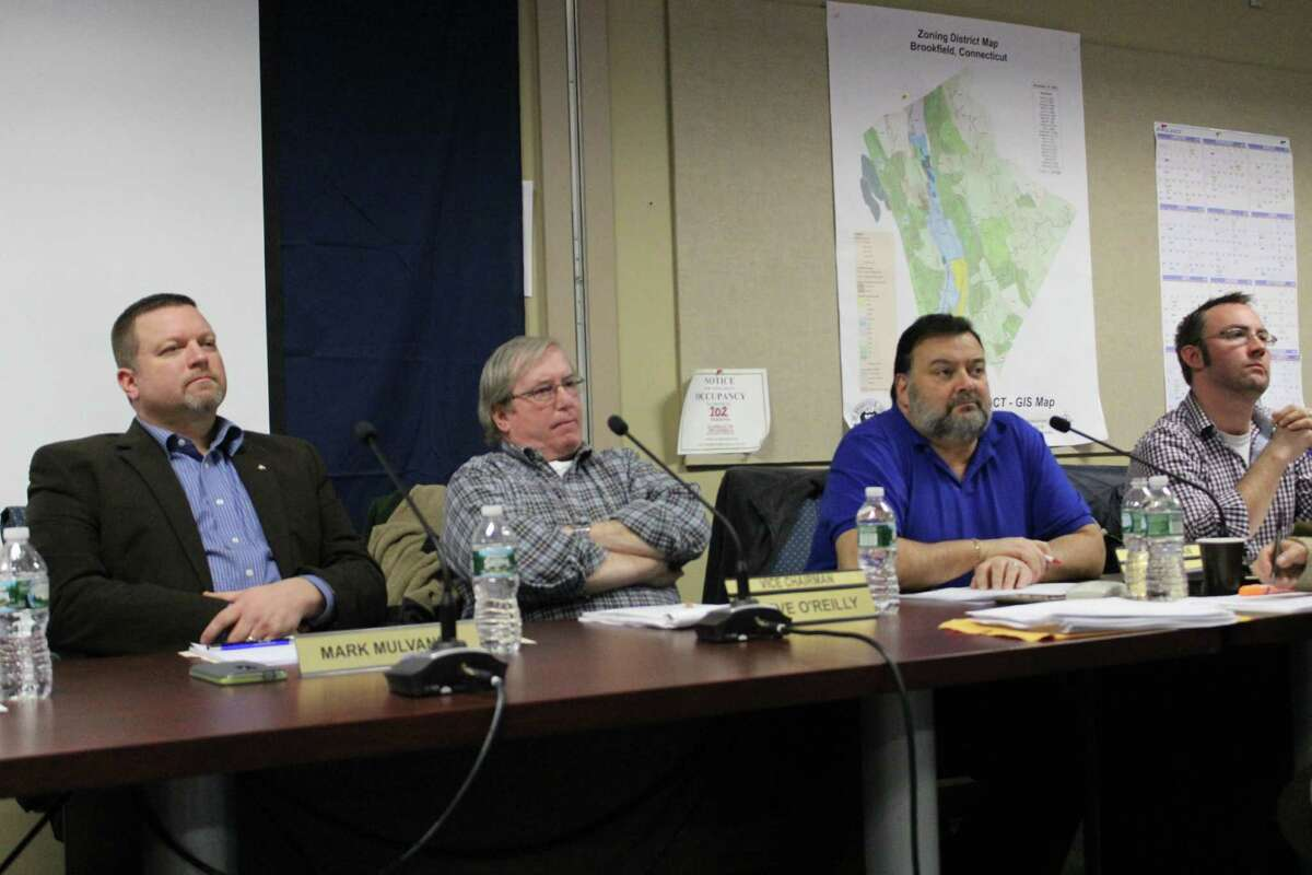 Board of Finance member Mark Mulvaney, Vice Chairman Steve O'Reilly, Chairman Rob Gianazza and member Sean Hathorn listen as Brookfield, CT residents speak in favor of town Controller Bill Leverence on Weds., Jan. 27, 2016.