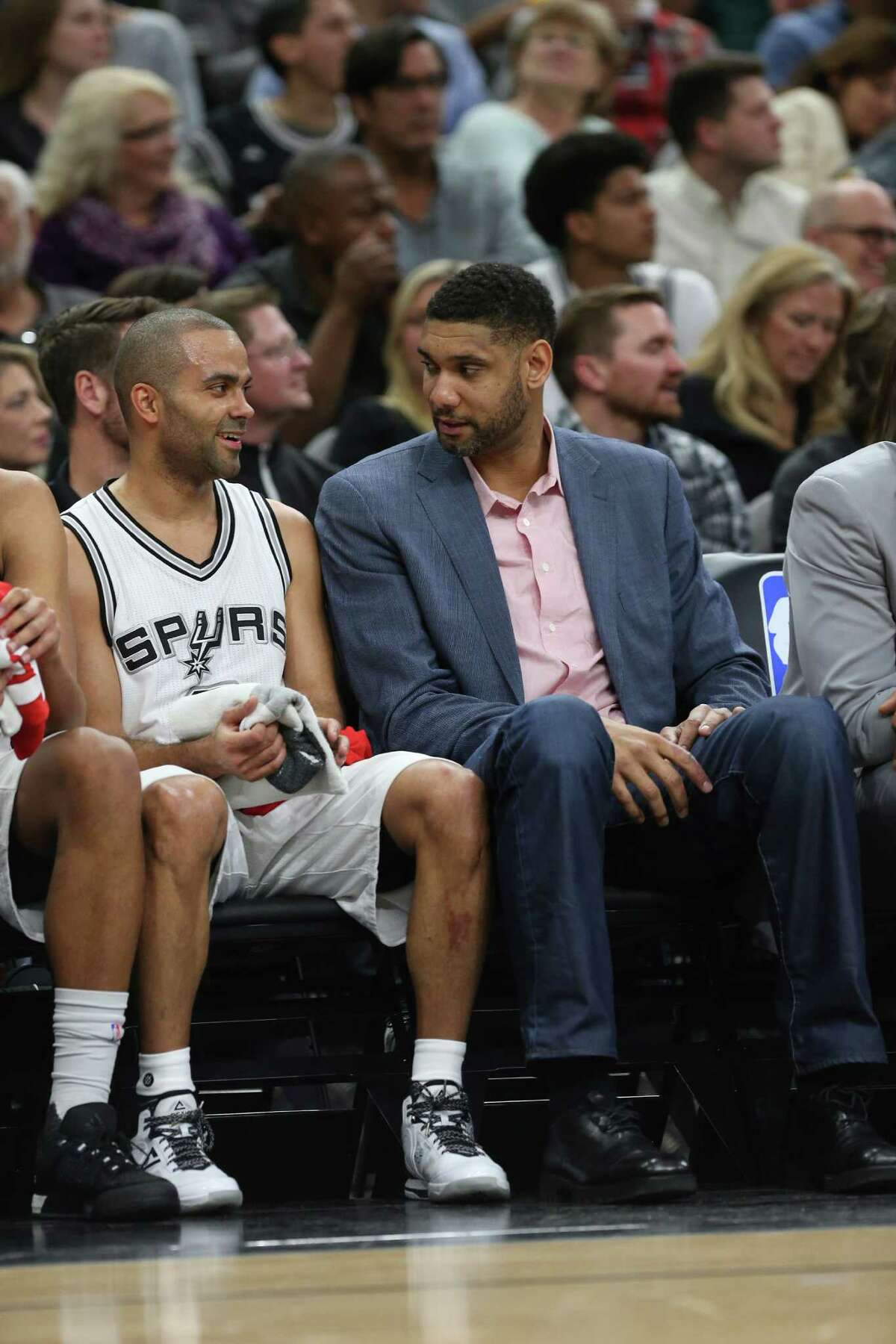San Antonio Spurs' Tim Duncan talks with Tony Parker during a break in the first half against the Houston Rockets at the AT&T Center, Wednesday, Jan. 27, 2016.