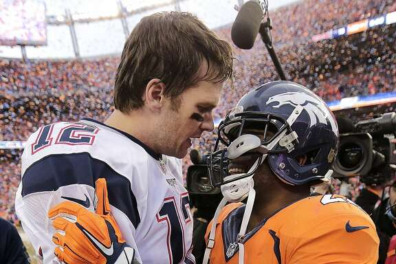 New England Patriots quarterback Tom Brady (12) speaks with Denver Broncos running back C.J. Anderson following the AFC Championship game between the Denver Broncos and the New England Patriots, Sunday, Jan. 24, 2016, in Denver. The Broncos defeated the Patriots 20-18 to advance to the Super Bowl. (AP Photo/Charlie Riedel)