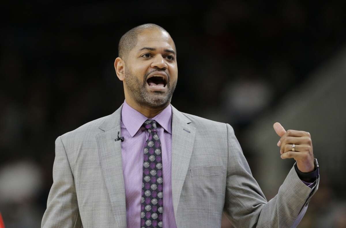 Houston Rockets coach J.B. Bickerstaff talks to his players during the first half of their NBA basketball game against the San Antonio Spurs, Wednesday, Jan. 27, 2016, in San Antonio. (AP Photo/Eric Gay)
