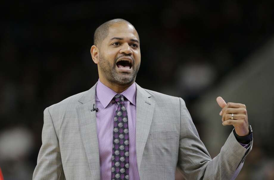 Houston Rockets coach J.B. Bickerstaff talks to his players during the first half of their NBA basketball game against the San Antonio Spurs, Wednesday, Jan. 27, 2016, in San Antonio. (AP Photo/Eric Gay) Photo: Eric Gay, Associated Press