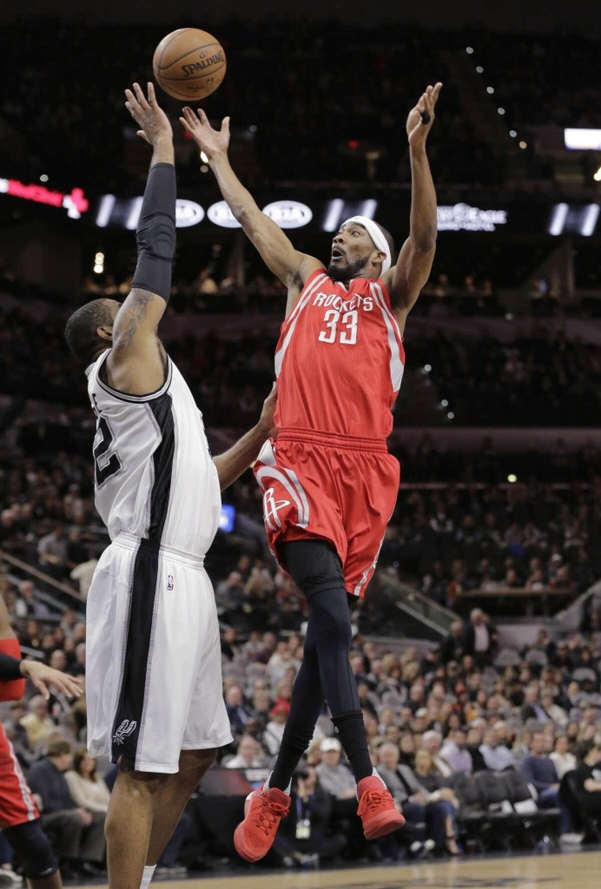 Houston Rockets guard Corey Brewer (33) shoots over San Antonio Spurs forward LaMarcus Aldridge (12) during the first half of an NBA basketball game Wednesday, Jan. 27, 2016, in San Antonio. (AP Photo/Eric Gay)