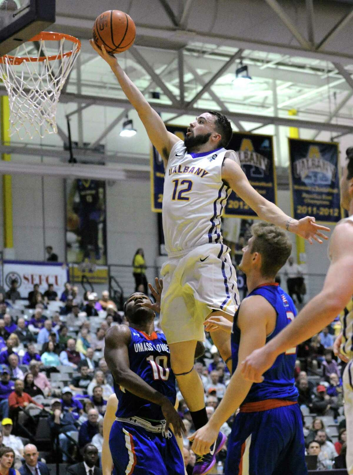 UAlbany's Peter Hooley goes in for a score during their men's college basketball game against UMass Lowell in an America East game at SEFCU Arena on Wednesday Jan. 27, 2016 in Albany, N.Y. (Michael P. Farrell/Times Union)