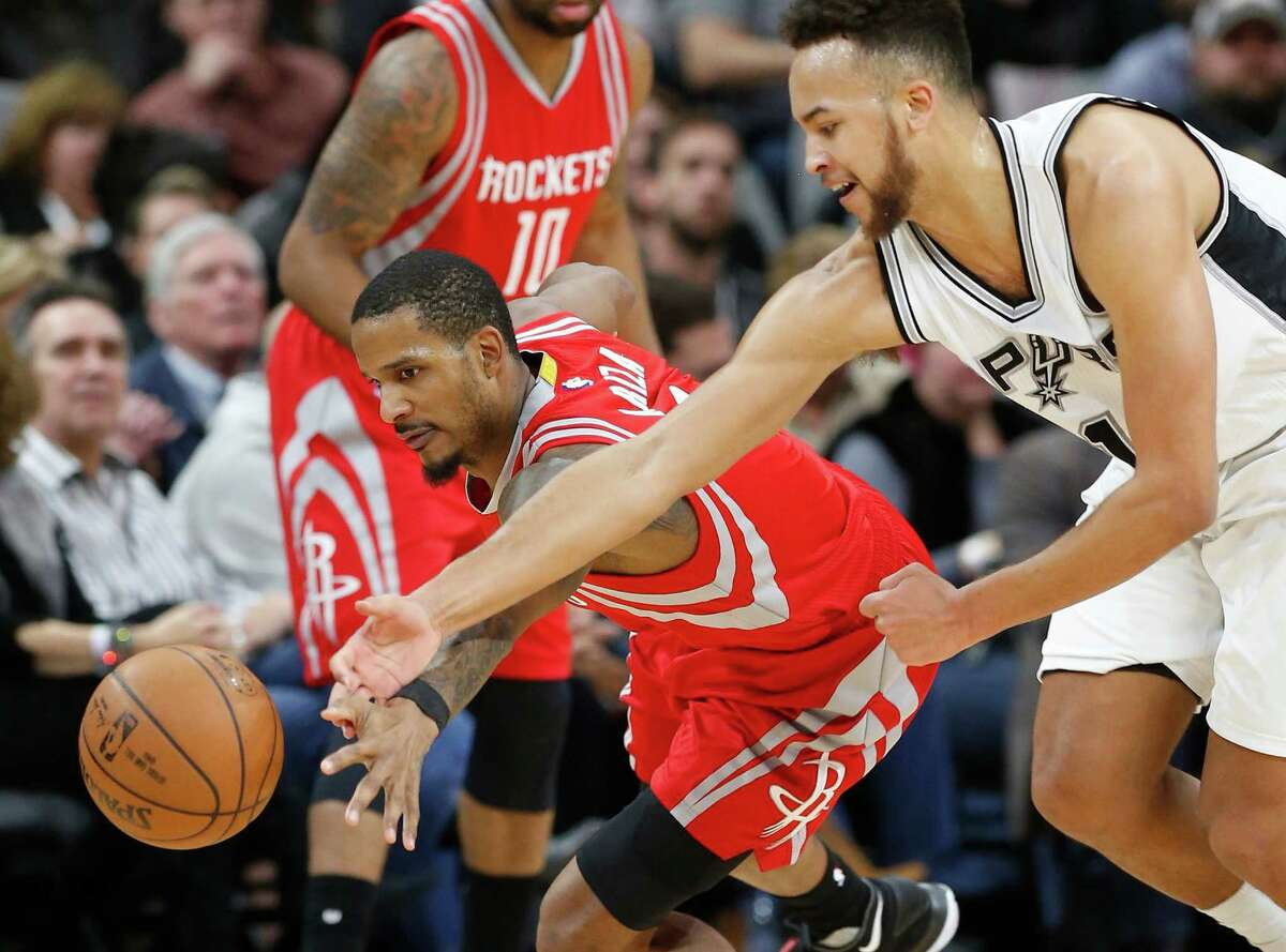 Spurs' Kyle Anderson (01) and Houston Rockets' Trevor Ariza (01) go for a loose ball at the AT&T Center on Wednesday, Jan. 27, 2016. Spurs defeated the Rockets, 130-99. (Kin Man Hui/San Antonio Express-News)