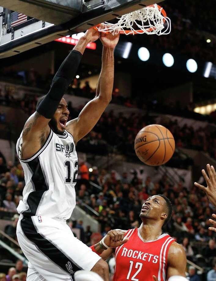 Spurs' LaMarcus Aldridge dunks on the Houston Rockets' Dwight Howard at the AT&T Center on Jan. 27, 2016. Photo: Kin Man Hui /San Antonio Express-News / ©2016 San Antonio Express-News