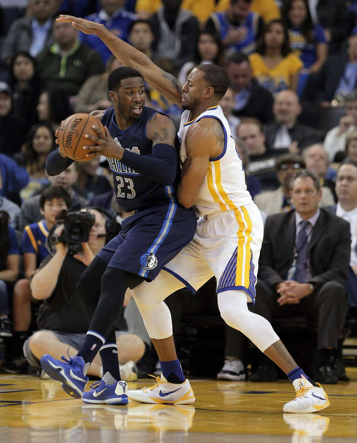 Andre Iguodala (9) guards against Wesley Matthews (23) in the first half as the Golden State Warriors played the Dallas Mavericks at Oracle Arena in Oakland, Calif., on Wednesday, January 27, 2016.