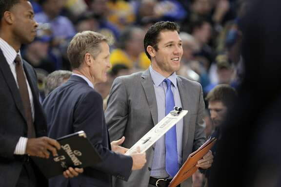 Steve Kerr and Luke Walton during a timeout in the first half as the Golden State Warriors played the Dallas Mavericks at Oracle Arena in Oakland, Calif., on Wednesday, January 27, 2016.