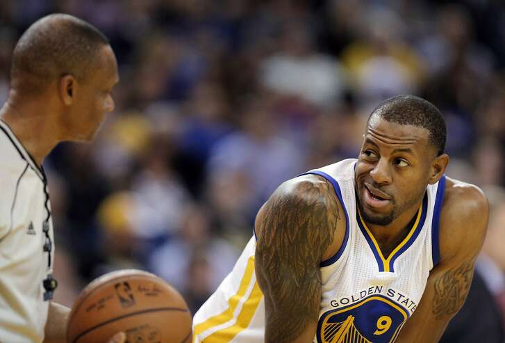 Andre Iguodala (9) chats with an official after a foul call against him in the second half as the Golden State Warriors played the Dallas Mavericks at Oracle Arena in Oakland, Calif., on Wednesday, January 27, 2016.