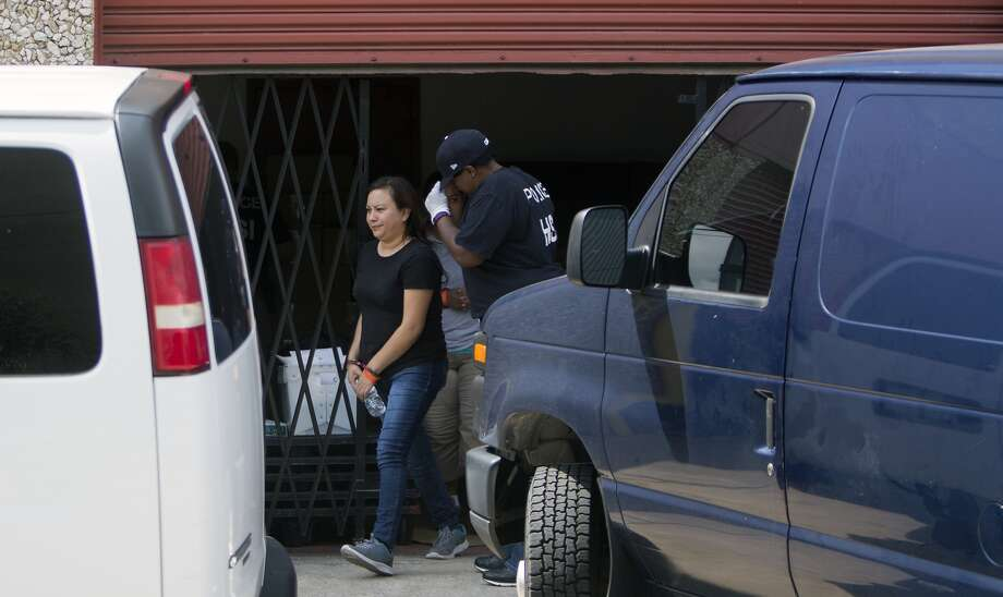 Federal agents raid a tortilla factory in the Heights, Tuesday, Aug. 4, 2015, in Houston. The raid began about 10 a.m. at La Espiga de Oro at 1200 15th Street near Shepherd. Eleven workers from the factory were detained at the scene. (Cody Duty / Houston Chronicle)
