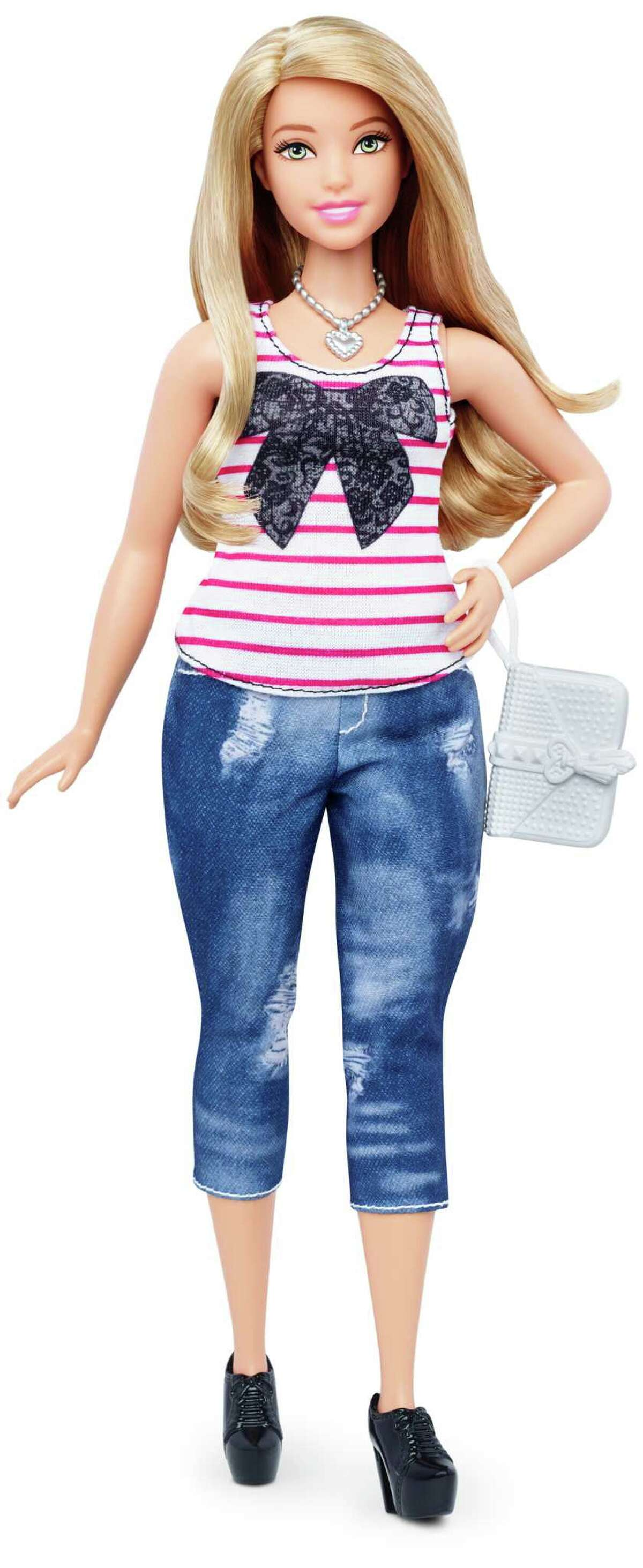 Curvy This photo shows a new, curvy Barbie Fashionista doll introduced in January 2016.