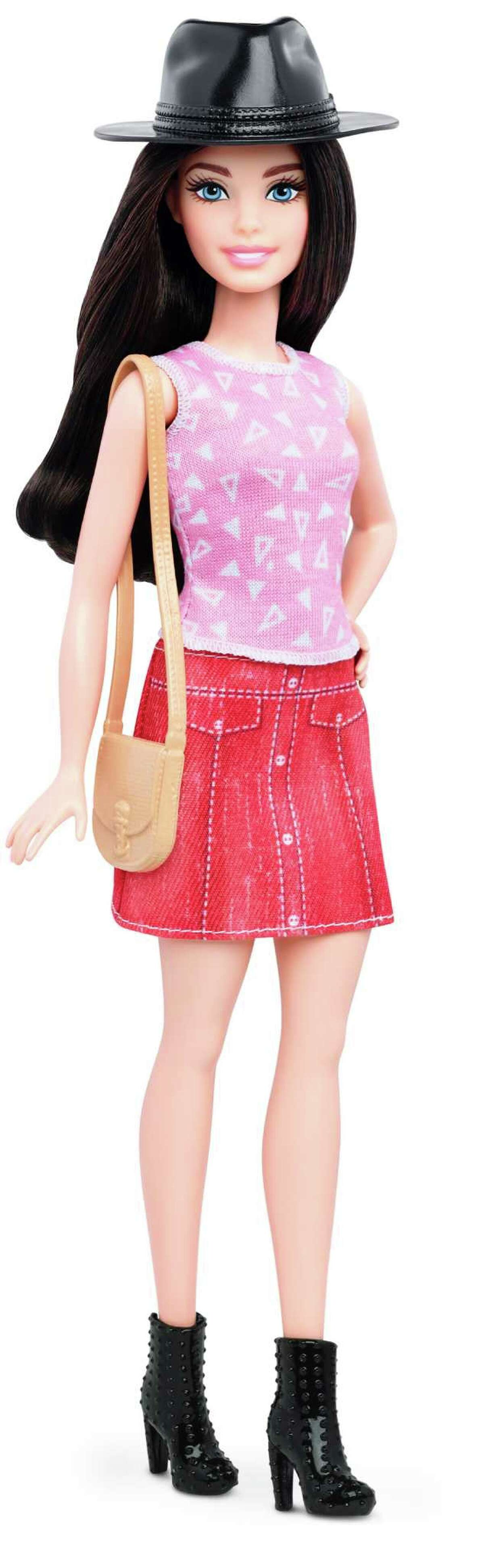 Petite This photo provided by Mattel shows a new, petite Barbie Fashionista, introduced in January 2016.