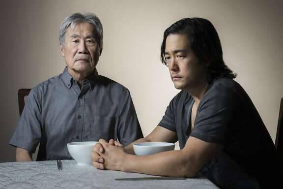 """Sab Shimono, left, and Tim Kang as a father and son trying to come to terms in Julia Cho's """"Aubergine"""" at Berkeley Rep"""