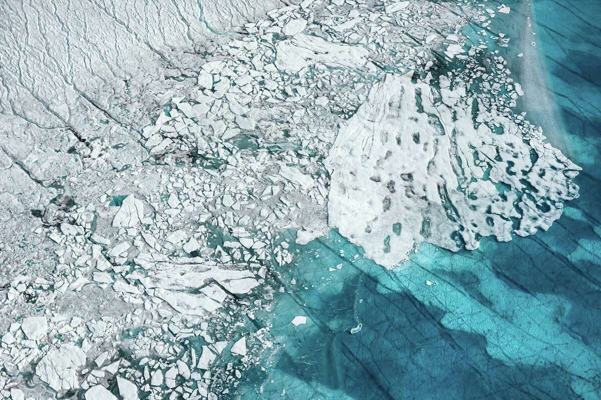 FotoFest explores global warming with works including Daniel Beltrá's shot of the Greenland ice sheet.