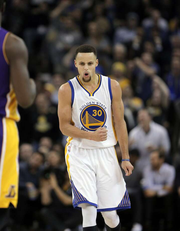 Stephen Curry (30) reacts after hitting a three-point shot in the second half the Golden State Warriors played against the Los Angeles Lakers at Oracle Arena in Oakland, Calif., on Thursday, January 14, 2016. Photo: Carlos Avila Gonzalez, The Chronicle