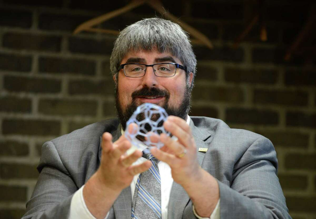 Library director Geoff Kirkpatrick displays an item made with a 3Doodler 3D printing pen during a demonstration of 3D printers at the Bethlehem Public Library Monday, Oct. 19, 2015, in Delmar, N.Y. 3D printers are available for use in the library. (Will Waldron/Times Union)