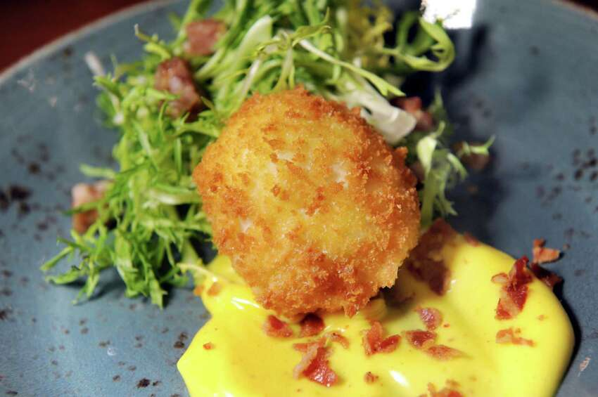 Deconstructed Scotch Egg with frisée and bacon hollandaise on Thursday, Jan. 21, 2016, at Wellington's in Albany, N.Y. (Cindy Schultz / Times Union)