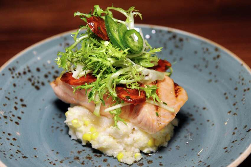 Faroe Island Salmon with Anson Mills grits, chorizo, apple, frisée and jalapeno gastrique on Thursday, Jan. 21, 2016, at Wellington's in Albany, N.Y. (Cindy Schultz / Times Union)