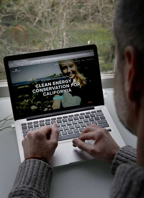 Michael Shellenberger pulls up his group's website at his Berkley home on Thurs. January 28, 2016, in Berkeley, Calif. Shellenberger is the co-founder of an environmentalist group that is banding together to save the Diablo Canyon Nuclear power plant from shutting down. Photo: Michael Macor, The Chronicle